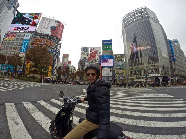 On a Vespa on worlds busiest crossing in Tokyo, Japan